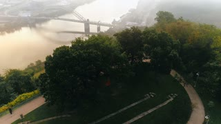 A cinematic tilt up aerial view of the Pittsburgh skyline on an early Autumn foggy morning.