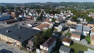 A daytime aerial establishing shot of a typical Pennsylvania small town neighborhood district.
