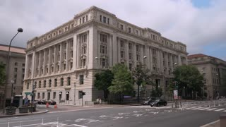 A daytime establishing shot of a typical government building on Pennsylvania Avenue in Washington, D.C.