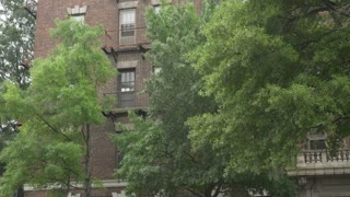 A daytime establishing shot of a typical Manhattan style apartment building.