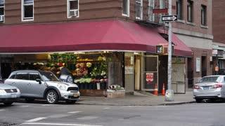 A daytime overcast establishing shot of a typical corner market in a Manhattan neighborhood.