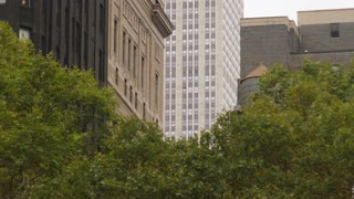 A daytime overcast exterior establishing shot (DX) of typical midtown Manhattan office and apartment buildings.