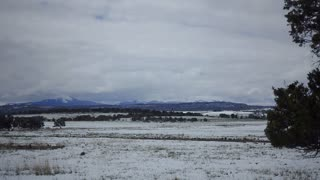A daytime overcast wintry establishing shot of the Colorado landscape.