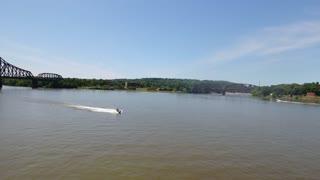 A daytime summer aerial establishing shot of an Ohio River jet skier.