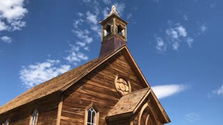 A daytime summer establishing shot of the Bodie Methodist Church in the old gold rush town of Bodie, California.
