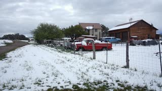 A daytime wintry establishing shot of a Colorado suburban home.