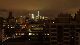 A dramatic night-to-day time lapse view of lower Manhattan and the Freedom Tower.