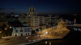 A dusk timelapse view of the city of Havana, Cuba and the shoreline of Havana Port Bay.