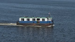 A ferry boat carries passengers on Havana Port Bay. Shot at 48fps.