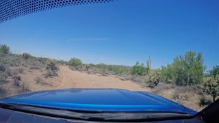 A forward perspective of driving off-road on the trails in Arizona on a sunny summer day. Shot at 60fps.