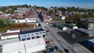 A forward rising aerial establishing shot of the business district of Canonsburg, Pennsylvania, a small town south of Pittsburgh, PA.