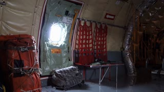 A looping background plate of an empty military cargo plane.