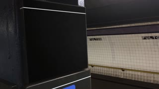 A New York subway train approaches a platform. Blank sign on pole for easy location identification customization.	With audio.