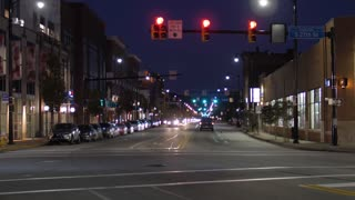 A night time lapse view establishing shot of traffic and buildings along East Carson Street in Pittsburgh's South Side district.