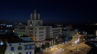 A night timelapse view of the city of Havana, Cuba and the shoreline of Havana Port Bay.