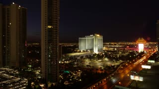 A night to day time lapse of the Las Vegas landscape. Hotels and residential buildings in the foreground.