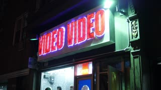 A nighttime establishing shot of a video store in Manhattan. Day/Night matching available.