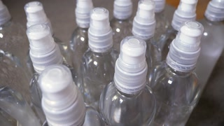 A slow dolly shot of clear water bottles.