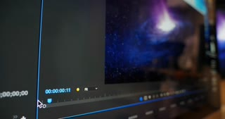 A slow tracking dolly closeup shot of a video editor interface screen playing video of a simulated spiral galaxy.
