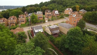 A slowly moving forward aerial view of a typical western Pennsylvania residential neighborhood.