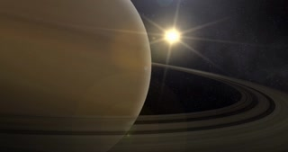 A slowly zooming out shot of Saturn and its rings in space.