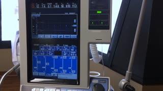 A ventilator machine monitors a hospital patient.