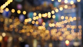 Abstract blurred bokeh hanging lights in a large city.
