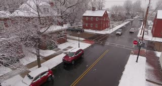 AMBRIDGE, PA - Circa March, 2017 - An aerial winter establishing shot of a small town residential neighborhood intersection.