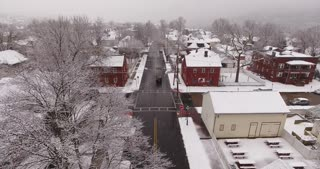 AMBRIDGE, PA - Circa March, 2017 - An aerial winter establishing shot of a small town residential neighborhood.