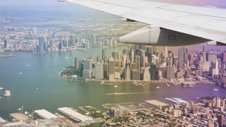 An aerial view of lower Manhattan as seen from the window of a landing jetliner.