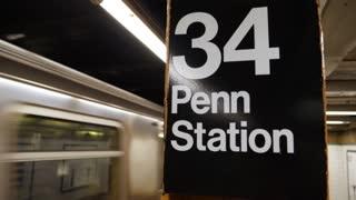 An establishing shot of a Manhattan subway train departing the 34th Street station.