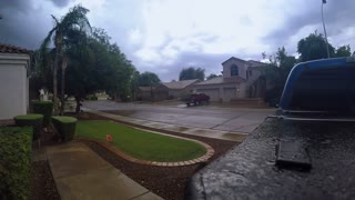An establishing shot of a summer storm over a typical Arizona residential neighborhood in a suburb of Phoenix. Shot at 60fps.