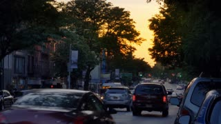 An evening establishing shot of businesses and traffic on Atlantic Avenue in Brooklyn.