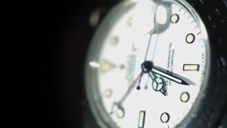 An extreme close-up of a luxury watch as the second hand passes by.