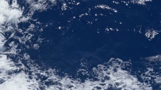 An extreme slow motion close up shot of rippling ocean waves. Shot at 144fps.