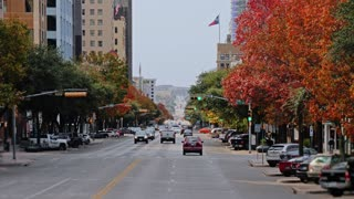 AUSTIN, TX - Circa December, 2017 - A long shot view of traffic and businesses along Congress Avenue in downtown Austin, Texas on an overcast day.