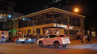 AUSTIN, TX - Circa December, 2017 - A nighttime establishing shot of a corner bar/restaurant on West 4th Street in downtown Austin, Texas. Day/night matching available.