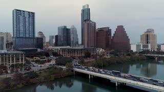 AUSTIN, TX - Circa December, 2017 - A rising dusk aerial Austin city establishing shot on an overcast evening.