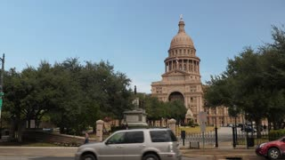 AUSTIN, TX - Circa December, 2017 - Traffic passes by the Texas state capitol in downtown Austin, Texas.