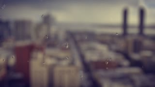 Background shot of rainy water drips on a window glass.