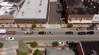 BEDFORD, OH - Circa September, 2018 - A downward aerial view above the business district of Bedford, Ohio on a late summer day.