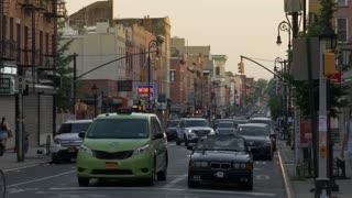 BROOKLYN, NY - Circa June, 2017 - An evening establishing shot of businesses and traffic near Atlantic Avenue in Brooklyn.