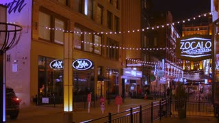 CLEVELAND, OH - Circa March, 2017 - A night time establishing shot of the restaurants and bars on East 4th Street in downtown Cleveland, Ohio.