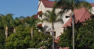 CORONADO ISLAND - Circa February, 2017 - A daytime establishing shot of a typical apartment building on Coronado Island outside of San Diego.