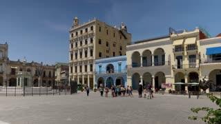 HAVANA, CUBA - Circa July, 2017 - A daytime exterior establishing shot of tourists visiting Havana's Old Town Square (Plaza Vieja). Shot in 5K.