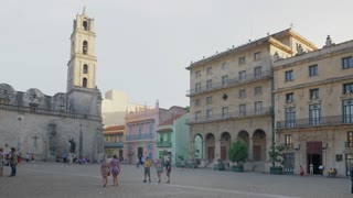 HAVANA, CUBA - Circa July, 2017 - A daytime exterior establishing shot of tourists visiting the Basílica San Francisco de Asís in the old town district of Havana, Cuba.