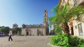 HAVANA, CUBA - Circa July, 2017 - A dolly up establishing shot of the Basilica Menor de San Francisco de Asis town square in Havana's historic district.