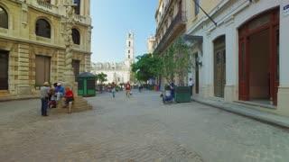 HAVANA, CUBA - Circa July, 2017 - A tracking POV dolly establishing shot of walking towards the Basilica Menor de San Francisco de Asis town square in Havana's historic district.