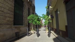 HAVANA, CUBA - Circa July, 2017 - A tracking POV dolly establishing shot walking in the narrow streets in Havana's old town district.