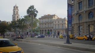 HAVANA, CUBA - Circa July, 2017 - An evening exterior establishing shot of traffic near the Basílica San Francisco de Asís in the old town district of Havana, Cuba.